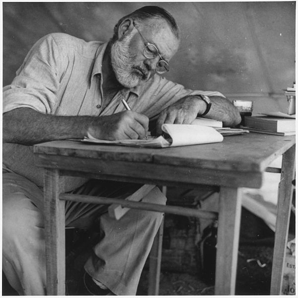 Ernest Hemingway Writing at Campsite in Kenya